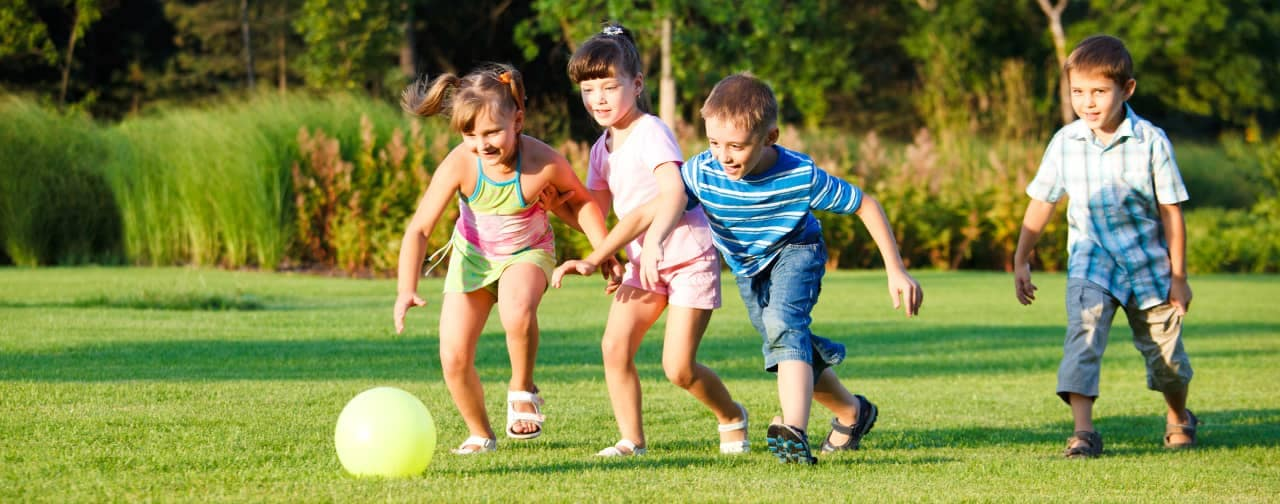 kids play in park with ball