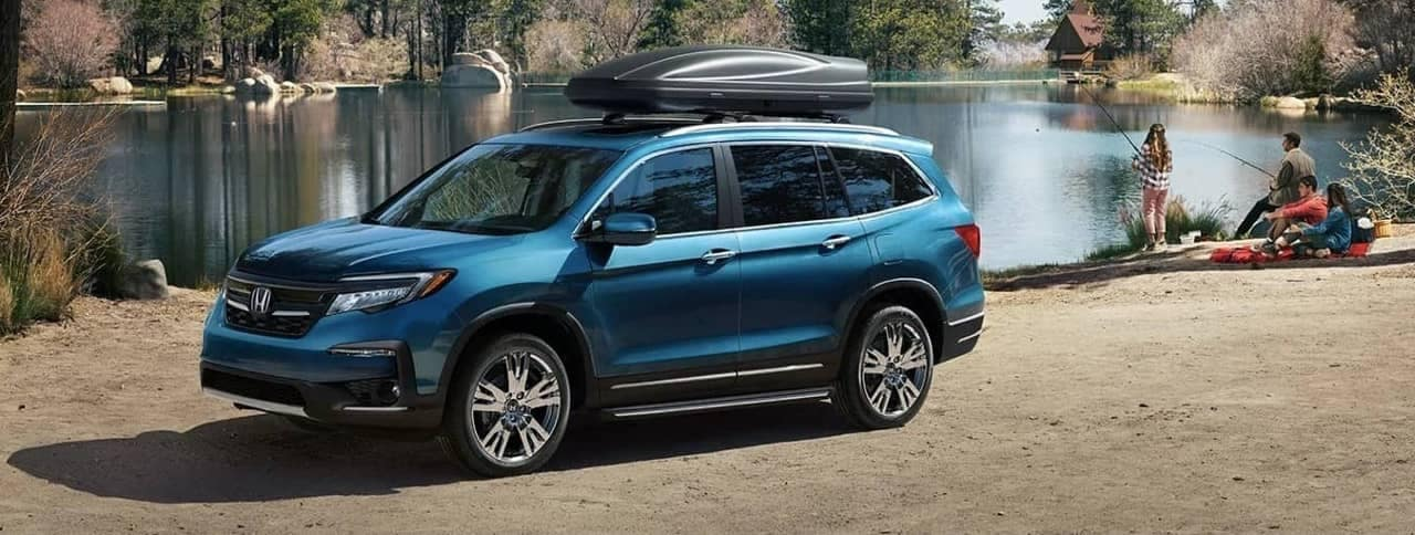 2020 Honda Pilot parked along lake