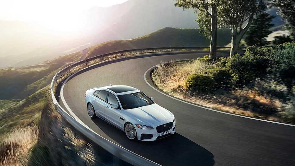 2019 Jaguar XF luxury sedan on mountain pass