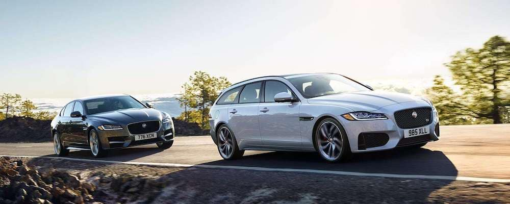 2019 Jaguar XF Sportbrake and Jaguar XF Sedan driving on coastal highway