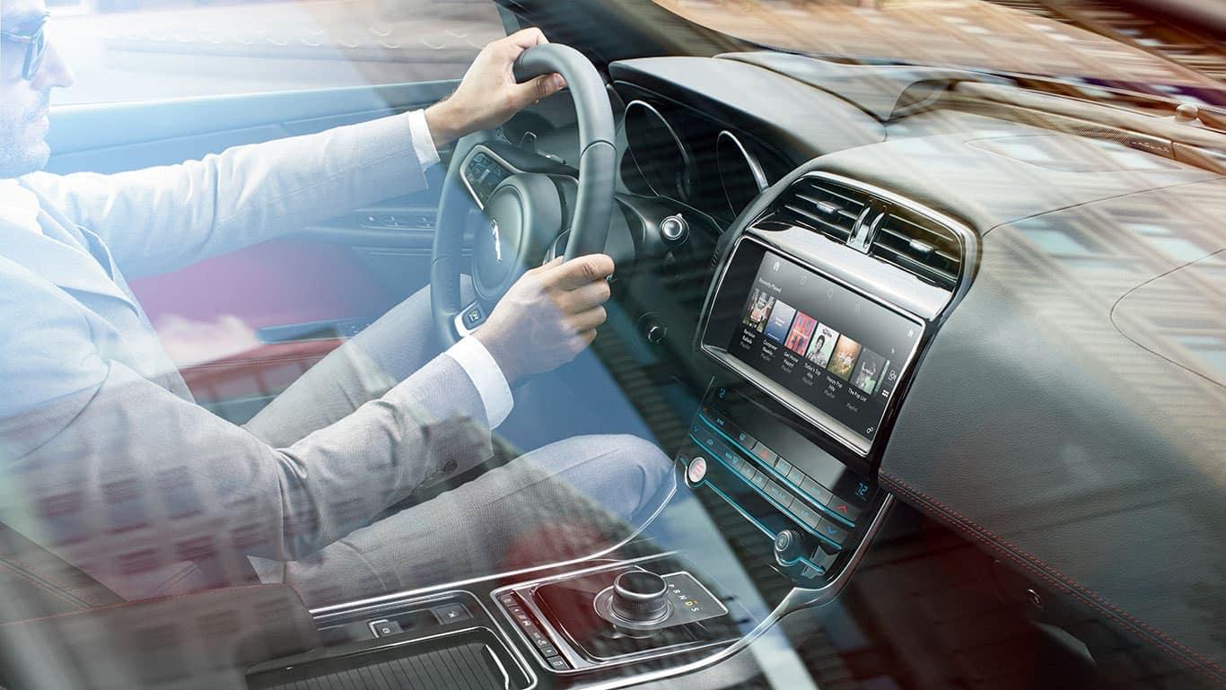 Man driving 2019 Jaguar XE