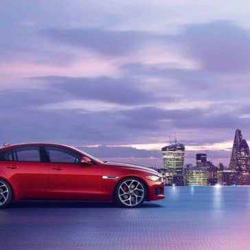 2019 Jaguar XE by a city at dusk
