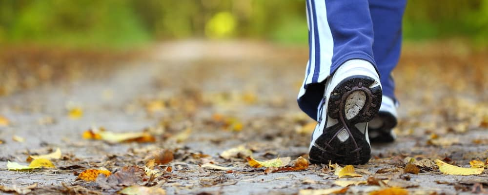 woman hiking on trail close of up gym shoes