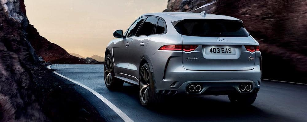 2019 jaguar f-pace in silver driving on mountain highway