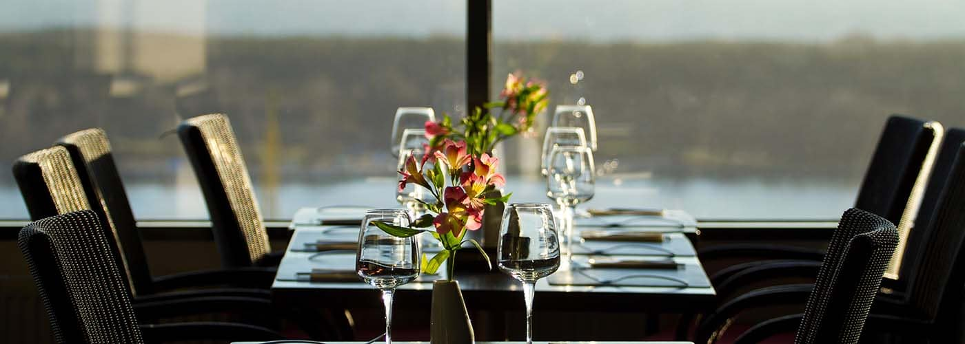Modern restaurant interior with scenic seaside view