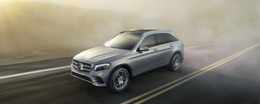 hybrid 2018 glc driving on highway with golden morning fog in background