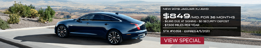 NEW 2019 JAGUAR XJ AWD. $849 PER MONTH FOR 36 MONTHS. $6,995 DUE AT SIGNING. $0 SECURITY DEPOSIT. $7,500 MILES PER YEAR. STOCK NUMBER 10358. EXPIRES 4.5.2020. VIEW SPECIAL. BLACK JAGUAR XJ PARKED OVERLOOKING VALLEY.