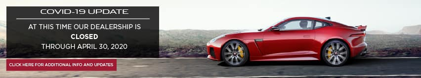 COVID-19 UPDATE. AT THIS TIME OUR DEALERSHIP IS CURRENTLY CLOSED THROUGH APRIL 30, 2020. RED JAGUAR F-TYPE COUPE DRIVING DOWN ROAD.