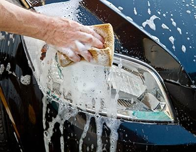 Person washing the exterior or their car