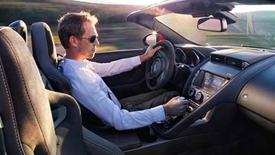 Man driving in a 2017 Jaguar F-TYPE