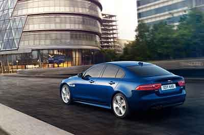 2018 Jaguar XE blue driving