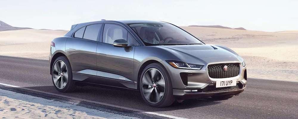 2019 Jaguar I-PACE in gray driving on desert highway