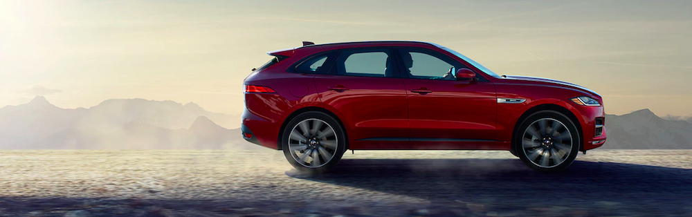 2020 jaguar f-pace red exterior shot driving