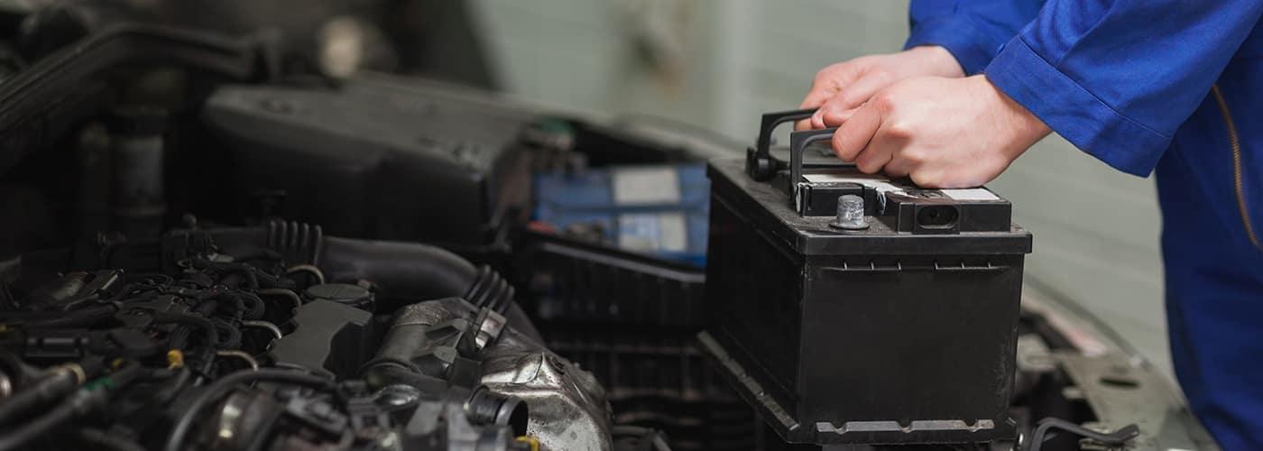 mechanic changing a car battery