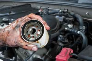Mechanic holding oil filter