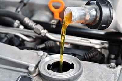 Oil being added to car