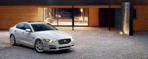 Jaguar XE Parked in front of house
