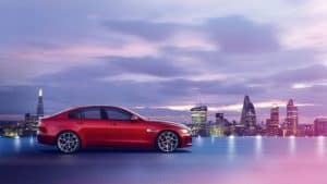 2019 Jaguar XE with the city in the background
