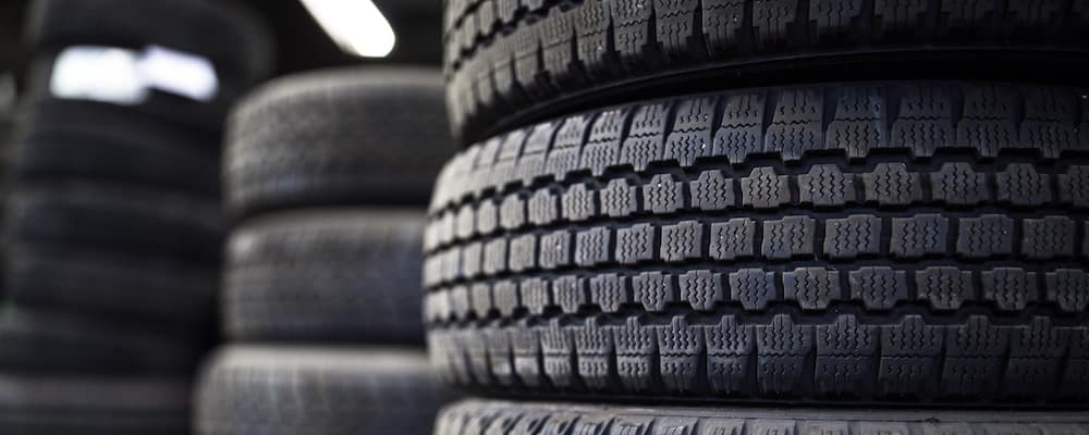 close up stack of tires with fluorescent lights in dark background