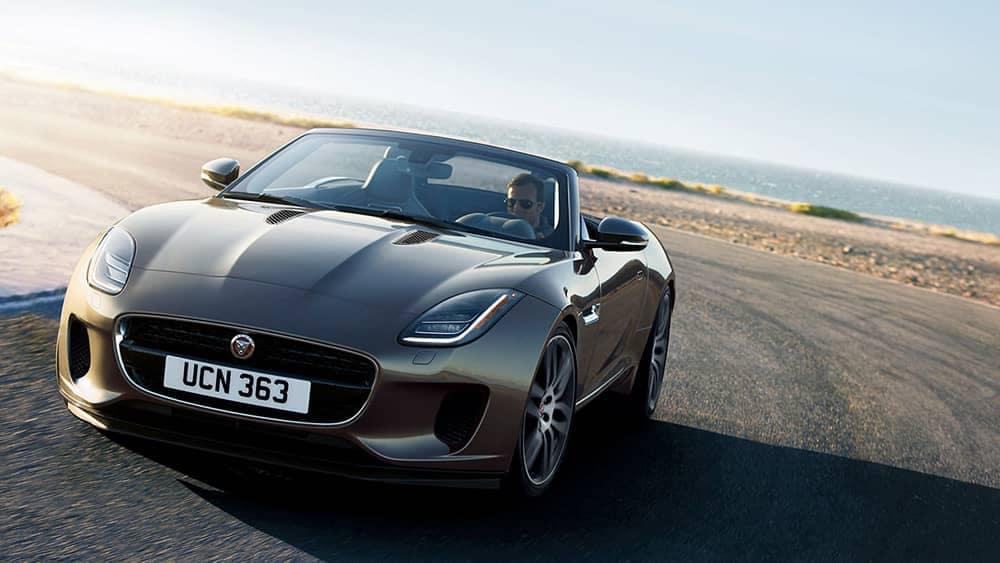 2020-Jaguar-F-TYPE-R-Dynamic-in-Silicon-Silver-driving-around-corner