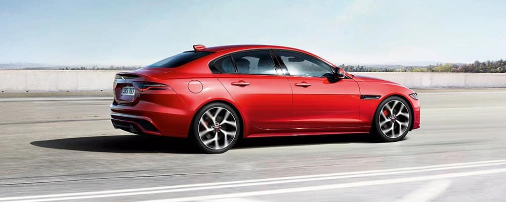 2020 Jaguar XE red driving on street