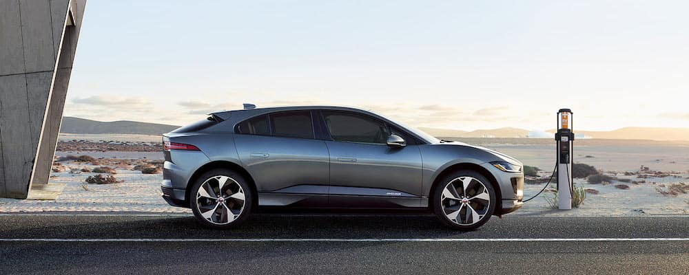 silver 2019 Jaguar I-PACE charging at station next to a higway