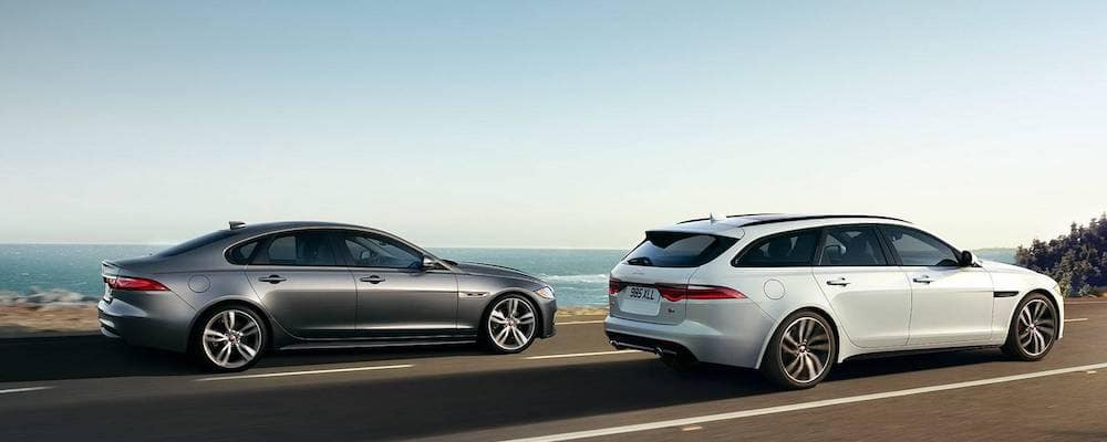 2019 Jaguar XF Sportbrake and 2019 Jaguar XF Sedan - Side View along coastal highway