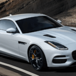2020 Jaguar F-TYPE checkered flag configuration driving on highway