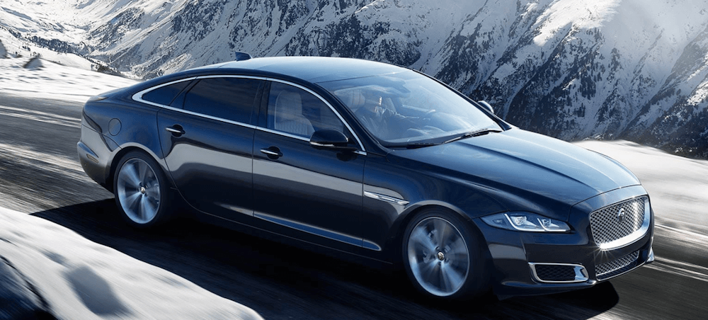 Jaguar XJ driving on mountain road