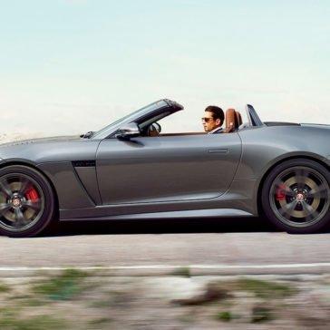 Couple driving 2017 Jaguar F-TYPE Convertible