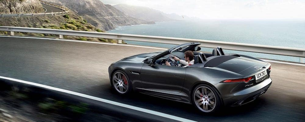 2020 Jaguar F-TYPE Checkered Flag Convertible in gray driving on coastal highway