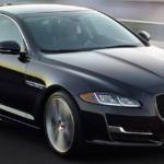 2019 jaguar xj black exterior driving on road