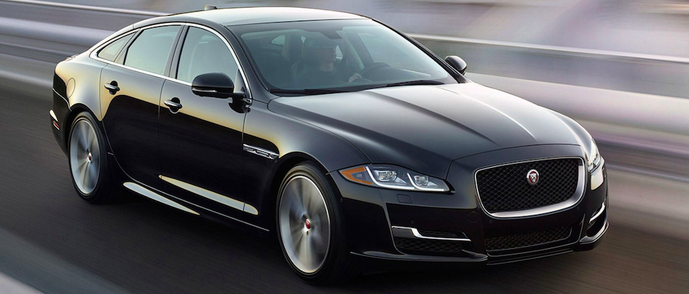 2019 jaguar xj black exterior driving on road
