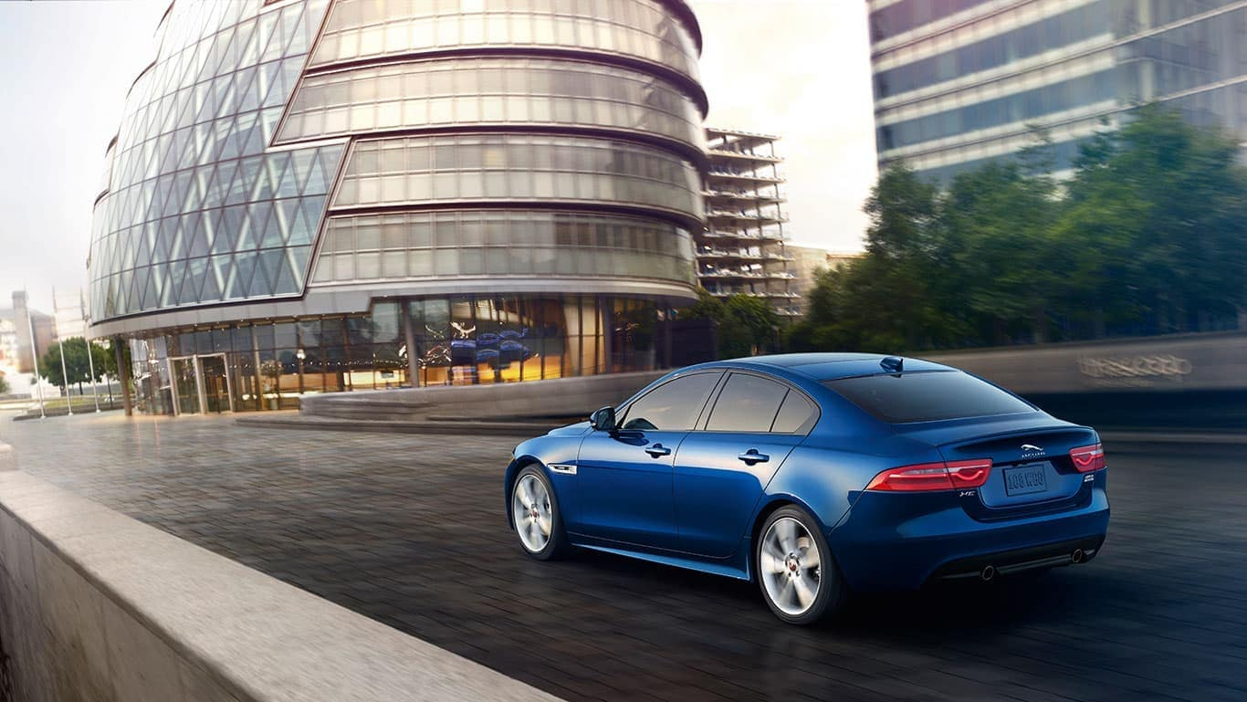 2019 Jaguar XE rear view city drive