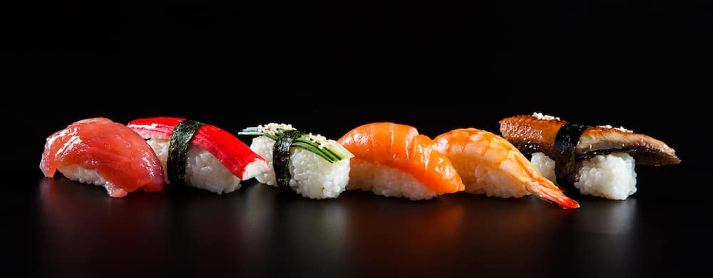 Sushi Rolls in front of Black Background