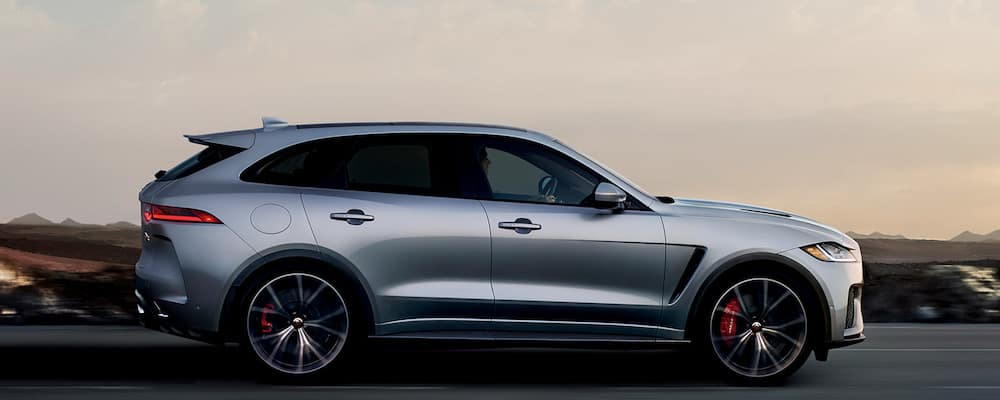 silver 2019 Jaguar F-PACE silhouette on open highway