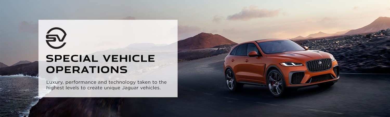 Orange Jaguar driving on road Special Vehicles Operations