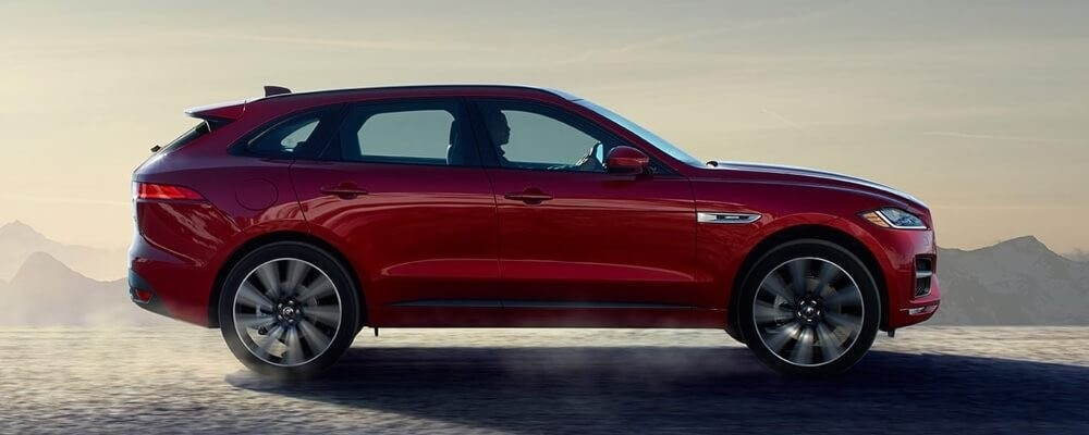 2018 Jaguar F-PACE red exterior side view