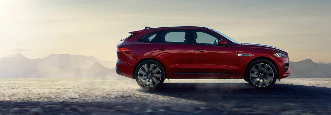 Red 2020 Jaguar F-PACE traveling through the desert