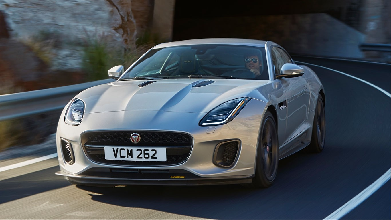 Man driving a 2018 Jaguar F-TYPE