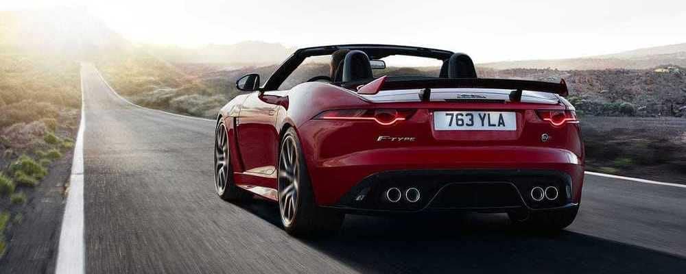 red jaguar driving fast