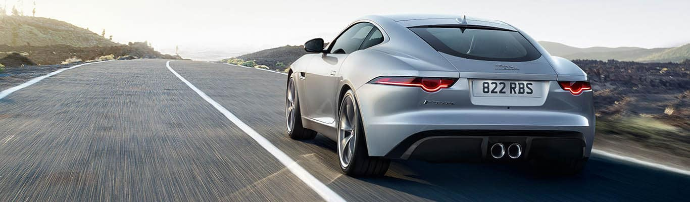 2018 Jaguar F-TYPE driving down the road