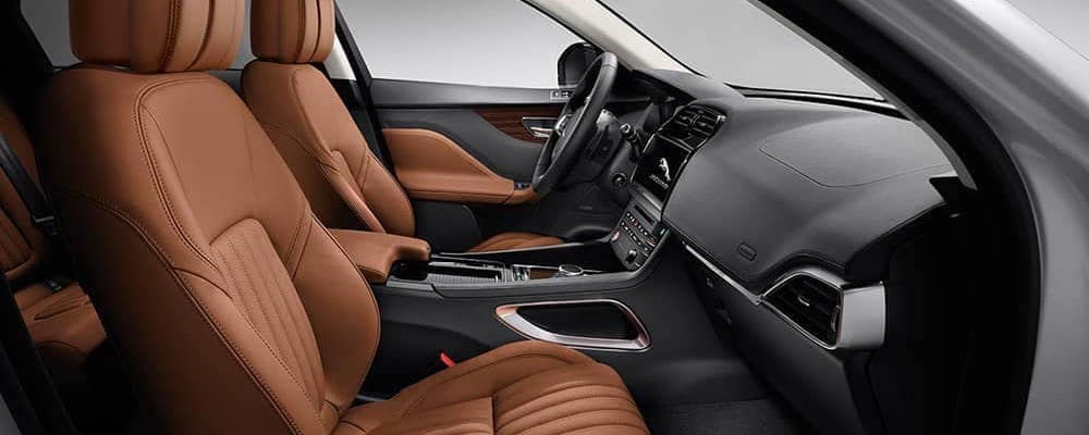 2019 jaguar f-pace interior view of front row with brown leather seats