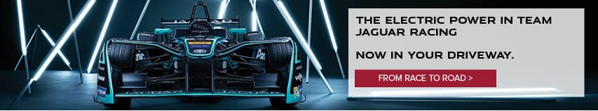 THE ELECTRIC POWER IN TEAM JAGUAR RACING NOW IN YOUR DRIVEWAY. FROM RACE TO ROAD. IMAGE FEATURES JAGUAR FORMULA E RACE CAR.