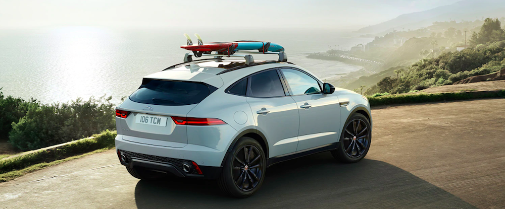 A 2020 Jaguar E-PACE on a road overlooking the ocean