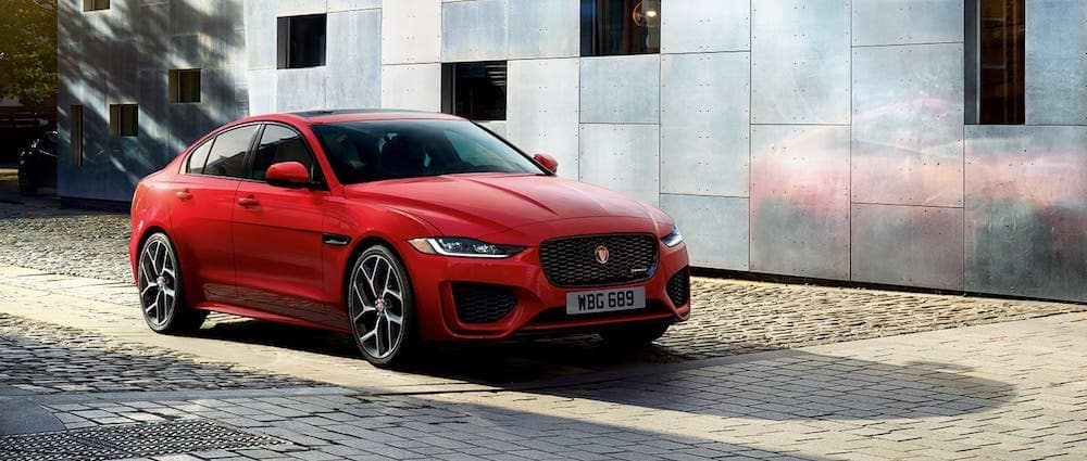 A 2020 Jaguar XE parked in front of a stylish building
