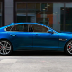 Blue 2021 Jaguar XF parked on street