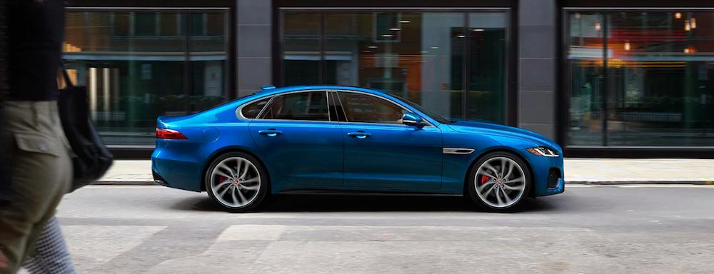 Blue 2021 Jaguar XF parked on street