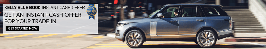 KELLY BLUE BOOK INSTANT CASH OFFER. GET AN INSTANT CASH OFFER  FOR YOUR TRADE-IN. GET STARTED NOW. LIGHT BLUE RANGE ROVER DRIVING THROUGH CITY,