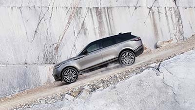2018 Land Rover Range Rover Velar driving down a gravel hill